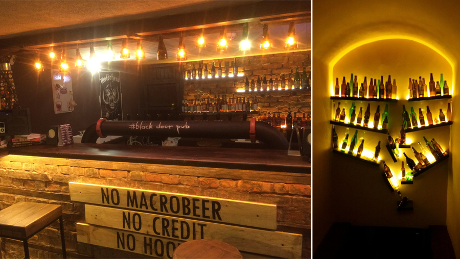 "Concept and decor of craft beer pub. ""Black Door Pub"""